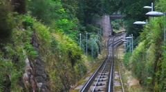 Departure the car to the cable car top station near the mountain Merkur in Baden Stock Footage