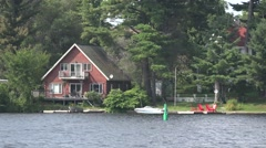 Cottage on a lake Stock Footage