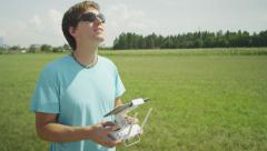 SLOW MOTION: Cheerful young pilot flying the RC drone Stock Footage