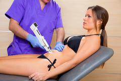 Abdominal mesotherapy gun therapy doctor to woman Stock Photos