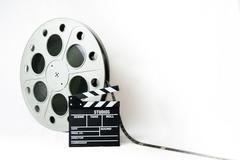 35mm cinema big reel with film and movie clapperboard - stock photo