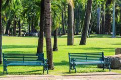 Green Benches in Tropical Garden Stock Photos