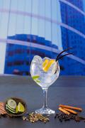 Stock Photo of Gin tonic cocktail with spices in urban city buildings