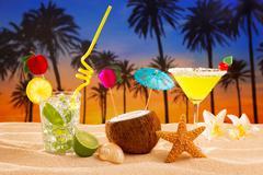 beach cocktail sunset on palm tree sand mojito margarita - stock photo
