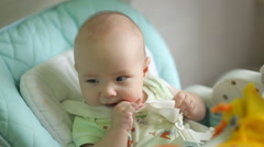 Baby Sits At A Table Stock Footage