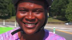 College Student in Bike Helmet Smiles at Camera Stock Footage