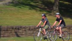 Two Guys Ride Bicycles on Pittsburgh Street - stock footage