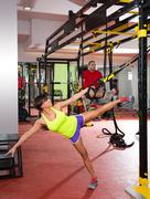 Fitness TRX training exercises at gym woman and man Kuvituskuvat