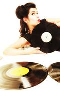 Stock Photo of Girl with phonography analogue records music lover