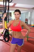 Crossfit fitness woman standing at gym holding trx Kuvituskuvat