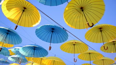 color umbrella heap diversity on blue sky in sunny day. - stock footage