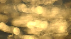 Water surface with waves glittering out of focus bokeh of golden sun reflected. Stock Footage