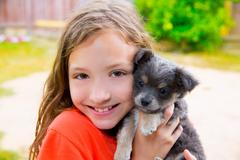 Beautiful kid girl portrait with puppy chihuahua doggy Stock Photos