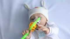 Child holding a rattle Stock Footage