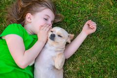 Blond happy girl with her chihuahua doggy portrait - stock photo