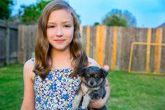 Beautiful kid girl portrait with puppy chihuahua doggy - stock photo