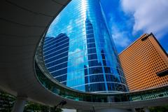 Houston downtown skyscrapers disctict blue sky mirror - stock photo
