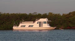 A houseboat at anchor in a peaceful Florida Keys bay Stock Footage