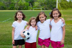 Soccer football kid girls team at sports fileld - stock photo