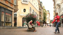 Unidentified tourists and locals on the street of small health resort town Stock Footage