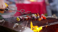 4K Freshly cooked food from the bbq is served to friends at outdoor party Stock Footage