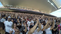 Soccer fans cheering in the stadium in Sao Paulo, Brazil Stock Footage
