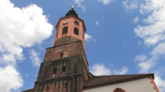 Clouds floating over  Catholic church. Katholisch Stiftskirche. Baden-Baden Stock Footage