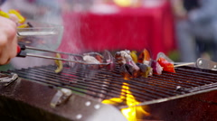 4K Freshly cooked food from the bbq is served to friends at outdoor party - stock footage