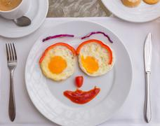 Happy Face Frying Eggs breakfast Stock Photos