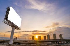 Large Blank billboard ready for new advertisement with sunset. Kuvituskuvat