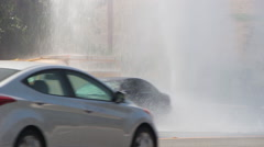 Traffic Moves Past Sheared Fire Hydrant Stock Footage
