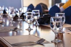 Elegance of glasses on table set up for dinning room. - stock photo