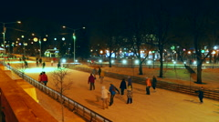 People ride on the open ice rink in Gorky Park in Moscow. Stock Footage