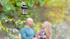 4K Happy attractive caucasian couple chatting by the bbq at outdoor party Stock Footage