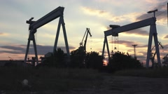 Shipbuilding Cranes On sunset Of Factory Buildings View From The Water, 4K Stock Footage