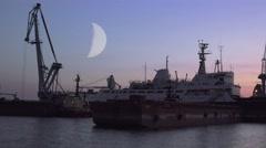 Moon over shipbuilding cranes, river, sea, night, 4K Stock Footage
