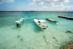 Small boats on nusa penida beach, Bali Indonesia - stock photo