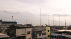 Rooftops with antennas in Medan city. 4K resolution time lapse. July 2015 Stock Footage