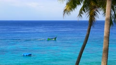 Tropical island sea view with palm trees and traditional boat. 4K resolution. Stock Footage