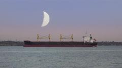 Moon over the cargo ship, river, sea, night, 4K Stock Footage