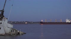Сargo ship on sunset of Factory Buildings View From The Water, 4K Stock Footage