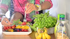 Woman cooking vegetable and fruit Salad. Stock Footage