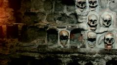 Wall of human skulls Stock Footage