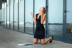 Girl knelt down and rejoices. Stock Photos