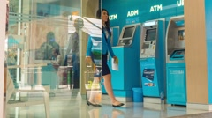 People Using ATM Cash Machine in Business Center. Time Lapse - stock footage