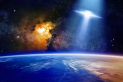 Ufo approaches planet Earth - stock photo