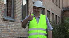 Happy construction employee showing thumb up Stock Footage