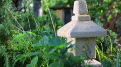 Garden stone Japanese lantern. Stock Footage