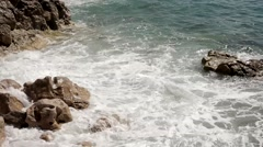 Waves breaking the rocks. Close up. Clean water. Stock Footage