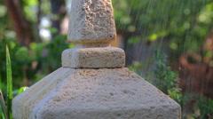 Raindrops falling on the Japanese stone lantern. Stock Footage